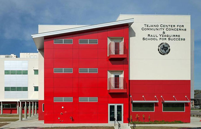 Outside of red and white building of Tejano Center.